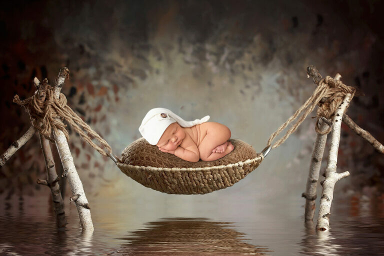Composite photograph of a newborn baby boy by Dallas/Fort Worth newborn photographer Chaunva LeCompte Photography