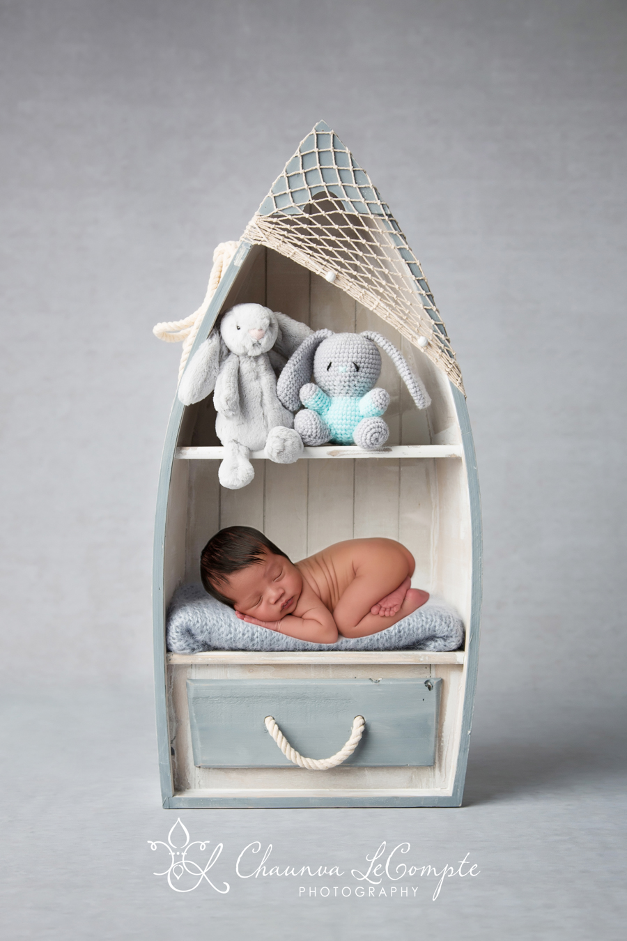 Photograph of newborn baby boy on a shelf with stuffed animals by Dallas / Fort Worth maternity, newborn, and children's photographer Chaunva LeCompte Photography