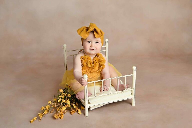 Photo of toddler on brass bed prop for milestone session image by Dallas / Fort Worth Maternity, Newborn, and Children's Photographer Chaunva LeCompte Photography